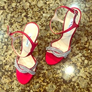 Elegant red metallic high heel sandals by Nina.